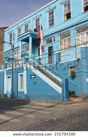 Colourfully painted houses in the world heritage city of Valparaiso in Chile - stock photo