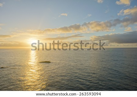 Colred Sunrise Clouds over the Atlantic Ocean in Tenerife Canary Islands - stock photo