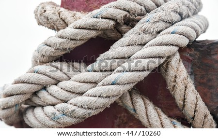 Colse up rope strapped to a steel pipes, Hemp rope strap on white background - stock photo