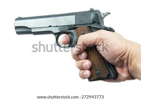Colt Mark IV series80 government m1911 in hand isolated a white background.