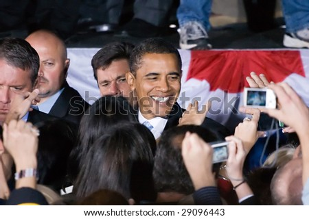 COLUMBIA, MO - OCTOBER 30, 2008: Then-Senator Barack Obama shakes hands with supporters after a speech at a campaign rally on the campus of the University of Missouri-Columbia on October 30, 2008. - stock photo