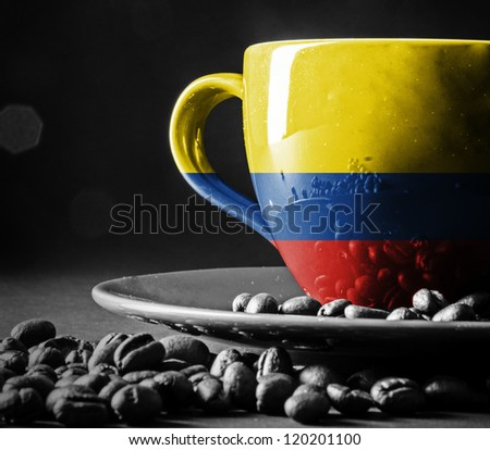 Columbian Flag on cup of coffee - stock photo