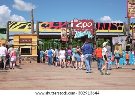 COLUMBUS, OH - AUGUST 1: People standing in line at Columbus Zoo and Aquarium during hot summer months on August 1, 2015 in Columbus, Ohio. - stock photo