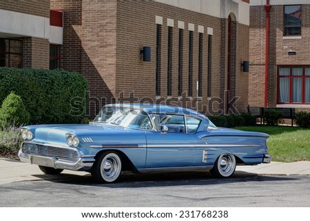 COLUMBUS, OHIO - CIRCA SEPTEMBER 14, 2014: Firefighters 4 Kids Classic Car and Motorcycle Show. A blue Chevrolet Impala is parked outside. - stock photo