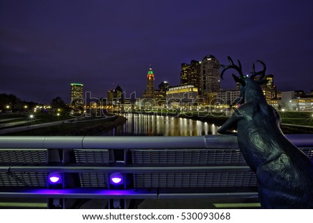 COLUMBUS, OHIO - DECEMBER 2, 2016:  The Columbus deer statue overlooks the skyline along the Scioto River.