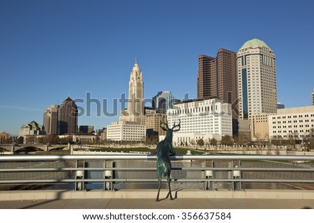 COLUMBUS, OHIO - OCTOBER 25, 2015:  The iconic deer statue stands on the Rich Street Bridge gazing at the city of Columbus. - stock photo