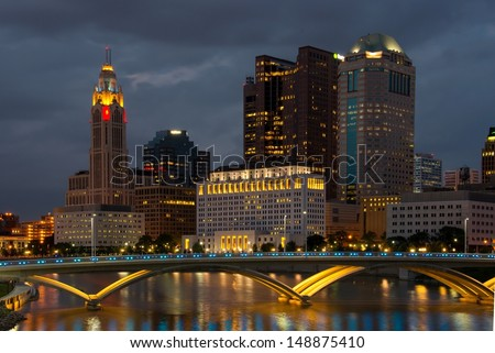 Columbus Ohio Skyline after Sunset with New Rich Street Bridge Lit in Blue Lights - stock photo