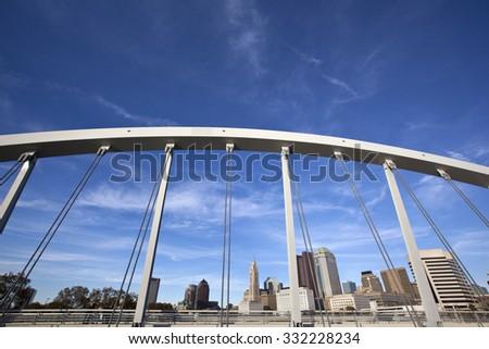 Columbus Ohio skyline framed by the Main Street Bridge - stock photo