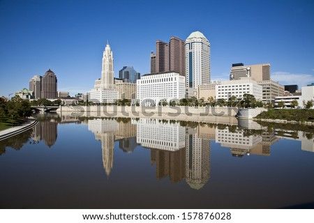 Columbus, Ohio skyline reflected in the Scioto River.  Columbus is the capital of Ohio - stock photo