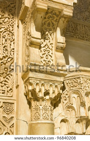 Column capital detail. Courtyard of the Lions: Hall of the two sisters. Nasrid Palaces. Fourteenth century. Alhambra, Granada, Spain - stock photo