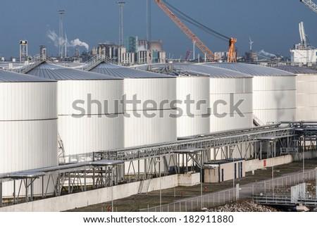 Column of Newly Built Storage Tanks - stock photo