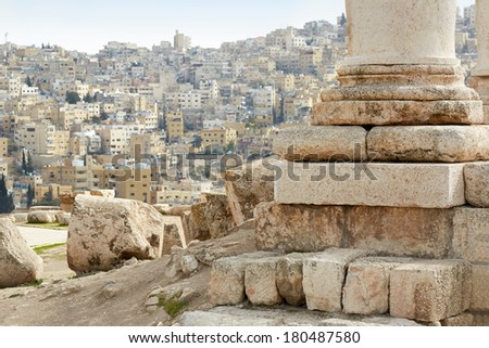 Column of temple of Hercules on the Amman citadel with city view, Jordan - stock photo