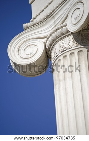column of white stone detail on blue background