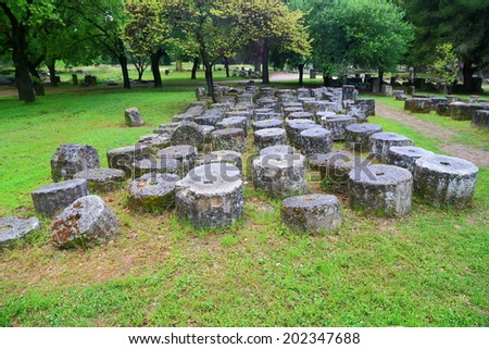 Column segments in ancient sanctuary at Olympia, Greece - stock photo