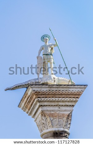 Column 12th Century with sculpture of Saint Theodore (Venice's first patron) Killing Crocodile in front of Palazzo Ducale near San Marco Basilica. Venice, Italy. Venice - UNESCO world heritage. - stock photo