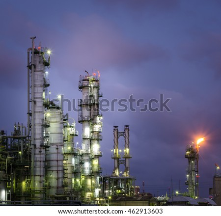 Column tower in petrochemical plant at twilight time