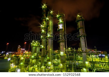 Column tower in the Olefins plant ; Petrochemical after sunset - stock photo