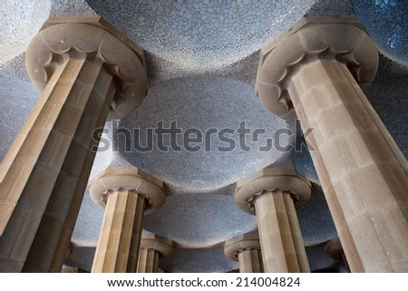 Columns and tiled domes of Hypostyle Room in Park Guell, Barcelona, Catalonia, Spain. - stock photo