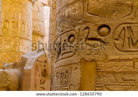 Columns' detail in the Karnak temple in Luxor, Egypt. Hieroglyphs - stock photo