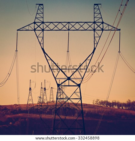 Columns high voltage power photographed in daylight. Toned - stock photo