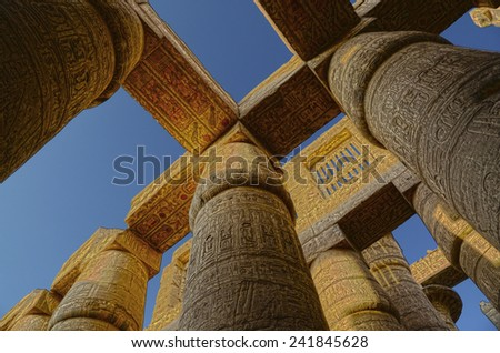 columns in karnak temple with ancient egypt hieroglyphics - HDR image  - stock photo