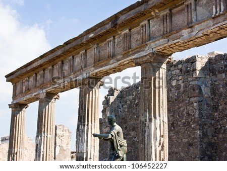 Columns in Pompeii with a figure in stone
