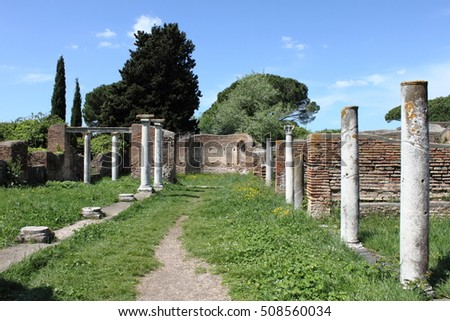 Columns of an ancient roman temple in Ostia Antica, the old harbour of Rome, Italy