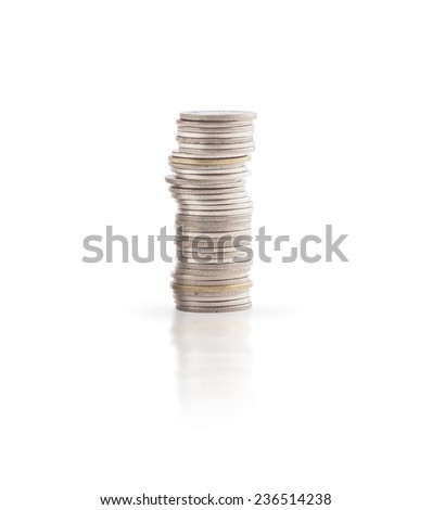 Columns of coins on white background. - stock photo