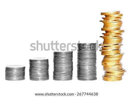 columns of gold and silver coins isolated on white background - stock photo