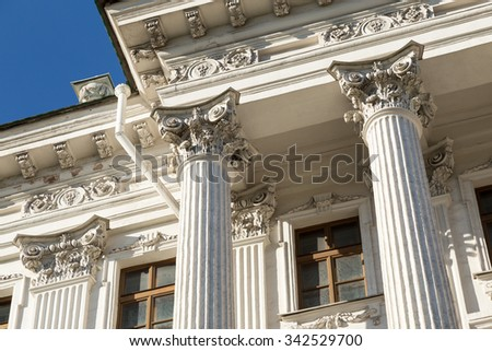 Columns on blue sky background. - stock photo
