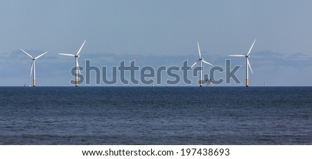 COLWYN BAY, WALES/UK - OCTOBER 7 : Wind turbines off shore at Colwyn Bay Wales on October 7, 2012