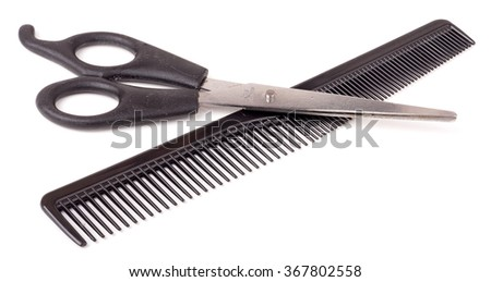 Comb and scissors isolated on the white background. - stock photo