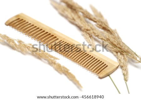 Comb and straw isolated on white. Dry damaged hair concept with copy space