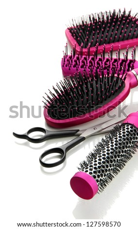 Comb brushes and Hair cutting shears, isolated on white - stock photo