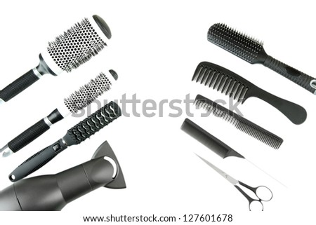 Comb brushes, hairdryer and cutting shears, isolated on white - stock photo