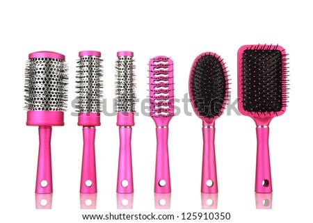 Comb brushes, isolated on white - stock photo