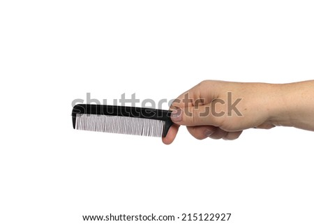 Comb in hand on a white background