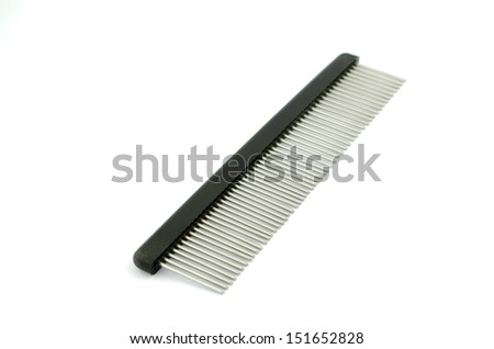 Comb with rotating tines for dog - stock photo