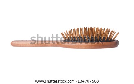 Comb. Wooden old combon the blackground - stock photo