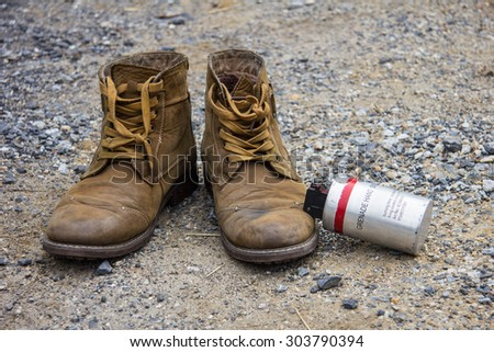 Combat boot and smoke bombs - stock photo