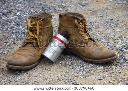 Combat boot and smoke bombs - stock photo