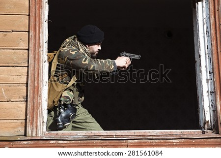 Combat ready to shoot on the mission - stock photo