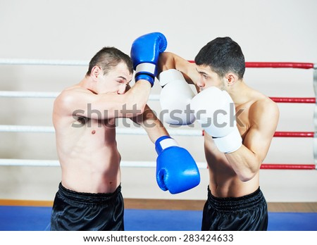 combat sport muai thai sportsman fighting at training boxing ring