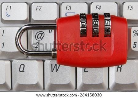 combination lock on key board - stock photo
