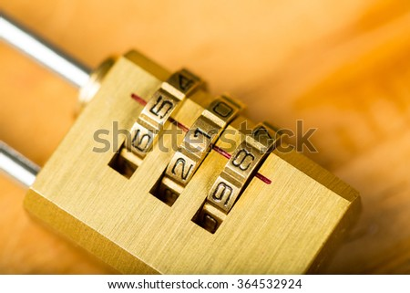 combination lock password on wood board. - stock photo
