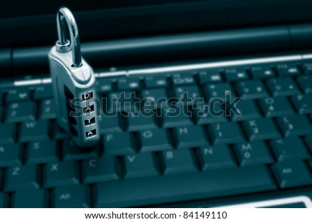 combination lock with data text on a laptop