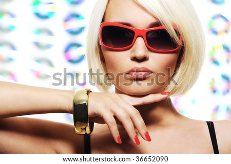 combination of red color in female sunglasses and nail enamel