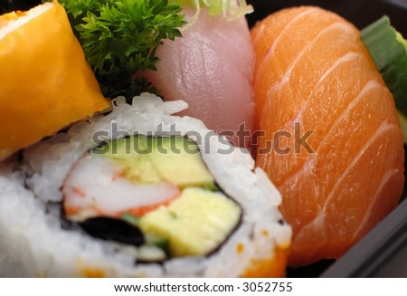 Combination of sushi pieces and rolls in macro. - stock photo