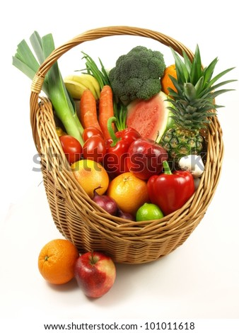Combination ofe different fruits and vegetables in basket - stock photo