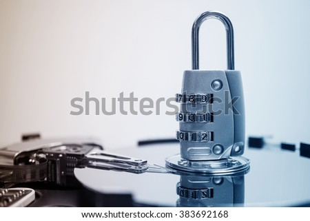 combination padlock on hard disk computer for security data concept - stock photo